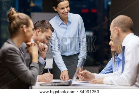 business, technology, people, deadline and team work concept - smiling female boss talking to busine