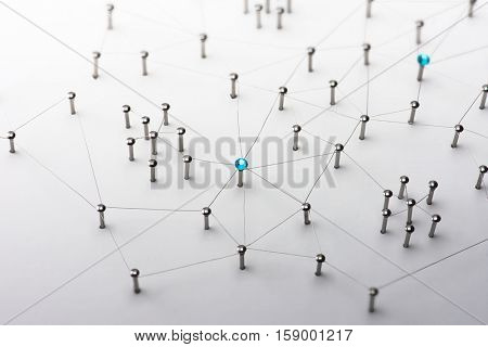 Linking entities. Network, networking, social media, connectivity, internet communication abstract. Web of thin silver wires on white background. Key Person or network hub. stock photo