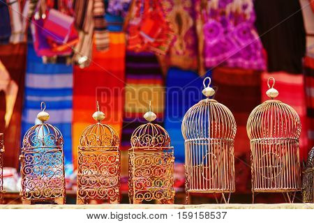Bird cages for sale on a street in Medina of Chefchaouen Morocco small town in northwest Morocco known for its blue buildings stock photo