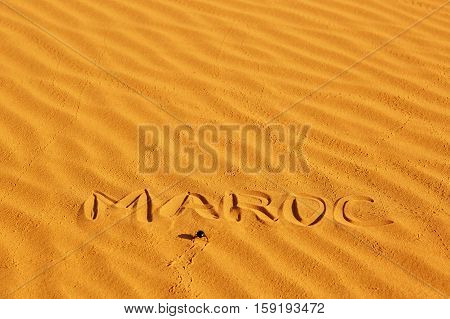 French word Maroc written on the sand in sand dunes in the Sahara Desert Merzouga Morocco stock photo