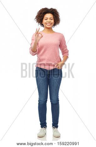 people, race, ethnicity and gesture concept - happy african american young woman showing ok hand sign over white stock photo