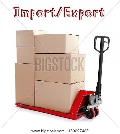 Text IMPORT/ EXPORT and palette truck with cardboard boxes on white background. Wholesale and logistics concept. stock photo
