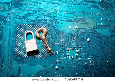 a security lock on a computer circuit board with unsuitable for the size key random password hacking concept stock photo