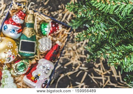 Box with vintage glass Christmas decorations view from above with space for text. stock photo