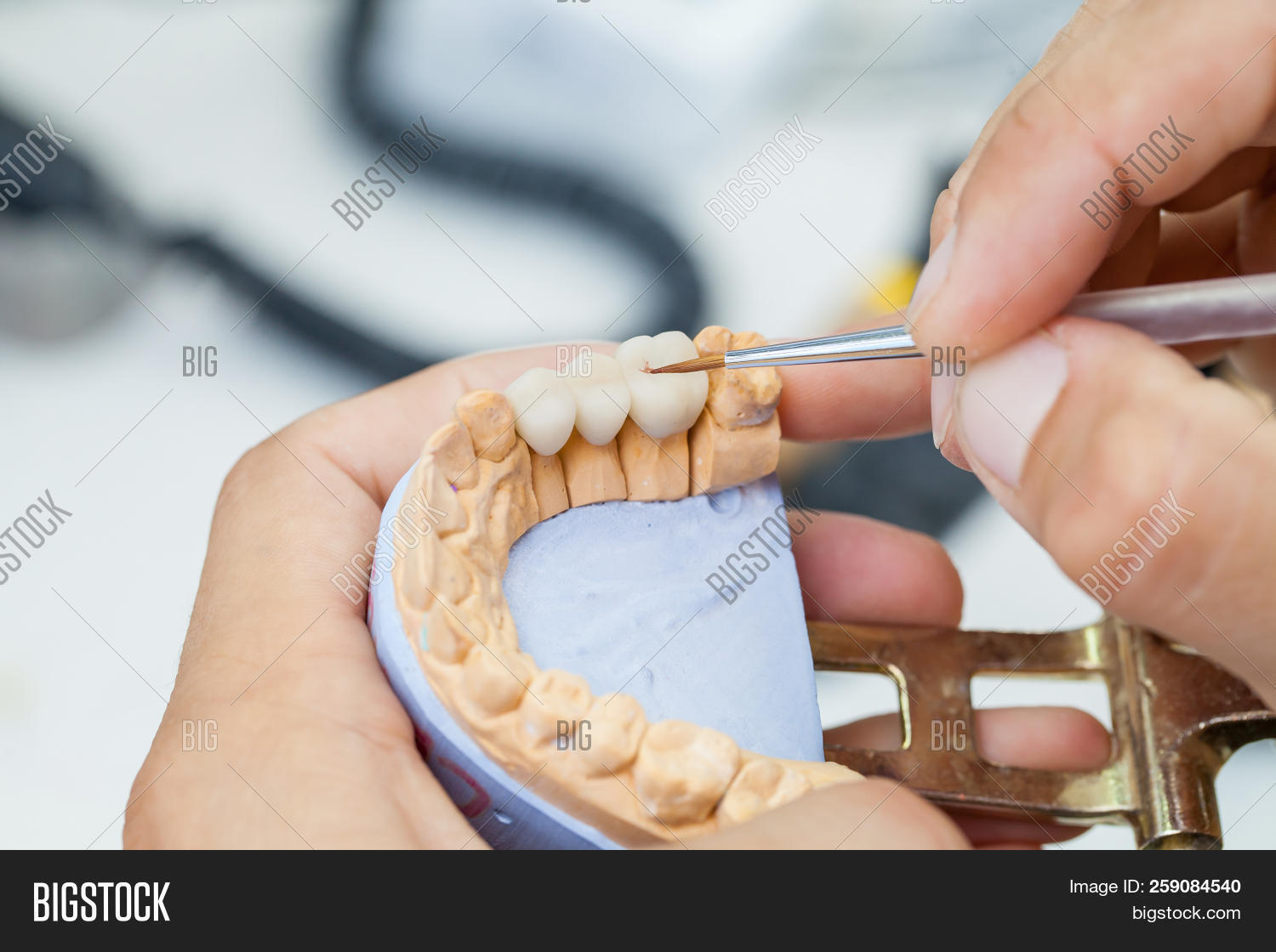 accurate,anatomy,apply,articulator,artificial,bridge,brush,care,cast,ceramic,clinic,close-up,crown,dental,dentist,dentistry,denture,doctor,dust,fake,hold,hygiene,implant,instrument,jaw,lab,laboratory,male,man,manufacturing,mechanic,medical,medicine,metal,model,mouth,oral,polish,porcelain,produce,production,profession,professional,prosthesis,prosthetics,technician,technology,tool,tooth,work