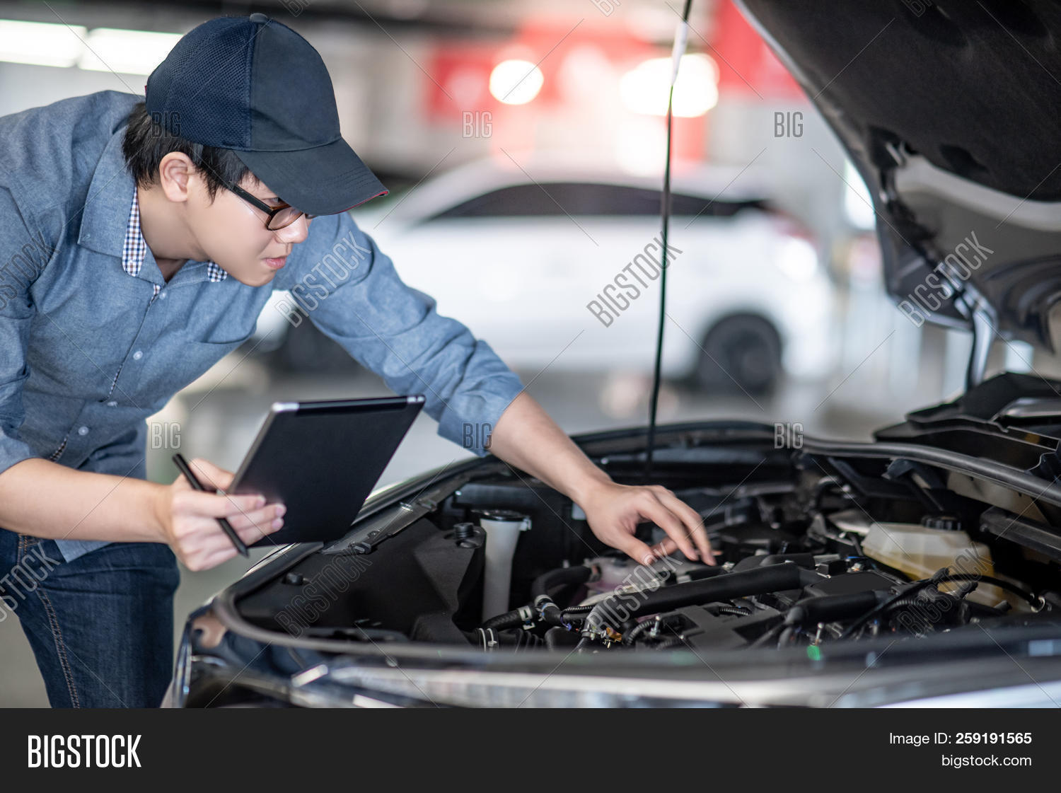 asian,auto,automobile,automotive,bonnet,business,car,check,checking,diagnosis,diagnostic,engine,engineer,engineering,equipment,fix,garage,handyman,hood,industry,inspection,job,machine,maintenance,male,man,mechanic,mechanical,motor,person,repair,repairman,report,safety,service,servicing,shop,specialist,station,tablet,technician,tool,transport,transportation,up,vehicle,work,worker,working,workshop