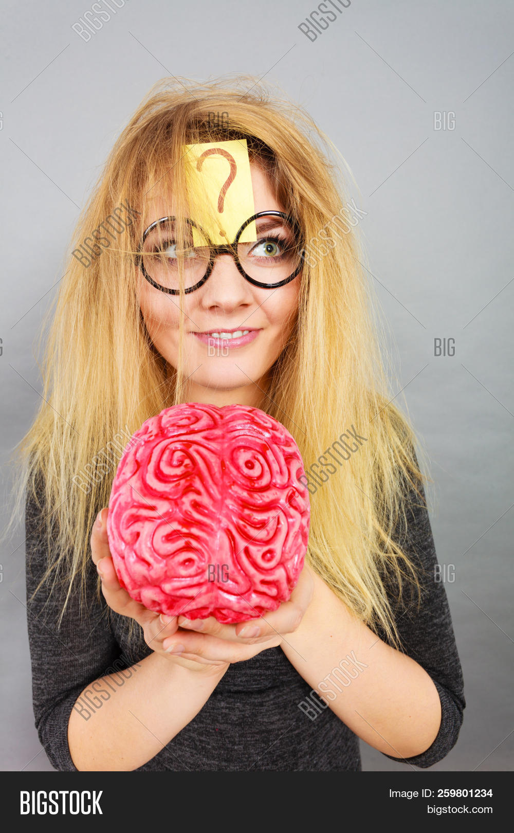anatomy,brain,clever,concepts,crazy,education,expression,eyeglasses,female,finger,glasses,head,idea,intellect,intelligence,knowing,knowledge,mark,mind,pointing,question,scientist,smart,student,thinking,understanding,weird,woman,wondering