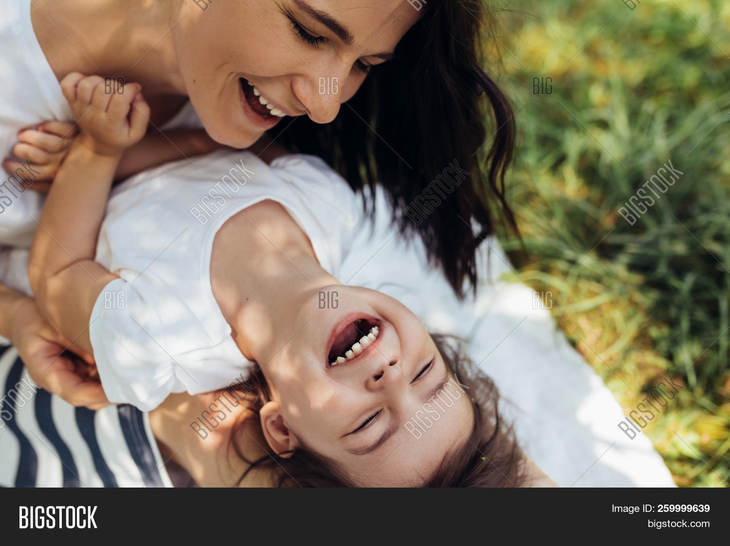 Cropped Beautiful Happy Mother And Her Little Smiling Daughter Outdoors. Cute Mom And Her Child Play