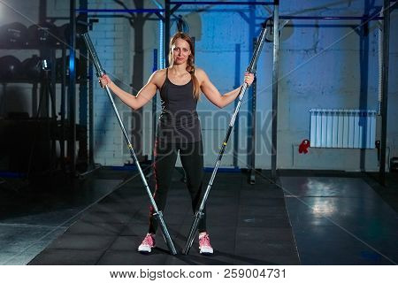 Beautiful fitness woman lifting barbell. Sporty woman lifting weights. Fit girl exercising building muscles. Fitness and bodybuilding. stock photo