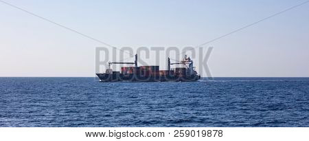 Container ship for international transport sail full of cargo. Sea commerce, blue sky background, banner. stock photo