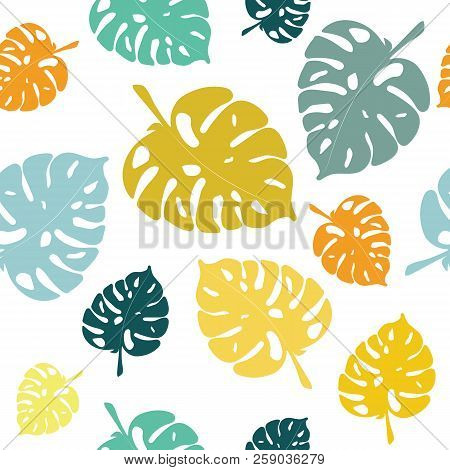 Turquoise, green and mustard-colored tropical leaves. Seamless pattern.  Can be used for stationery ,wallpaper , scrapbooking and textile, fabric prints. stock photo