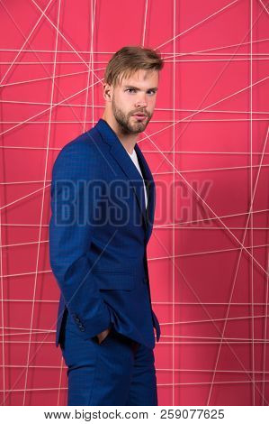 Male fashion. Man formal clothing looks handsome and confident. Menswear and stylish wardrobe concept. Proper outfit influence reputation in society. Man or businessman wear classic dark blue suit. stock photo