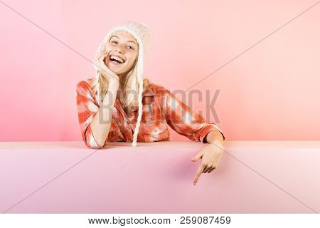 Beautiful girl with background board for Copyspace. Woman holding gold leaf on pinc background. Fashion girls. Girl advertises your goods and services stock photo