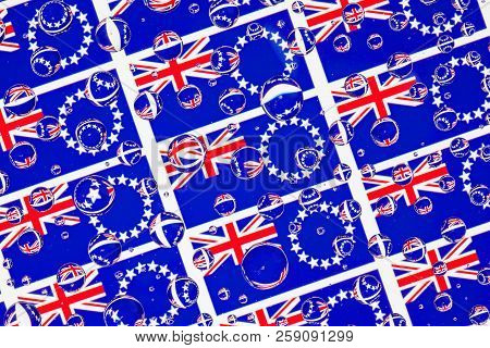 Flags  of Cook Islands, behind a glass covered with rain drops.Pattern from Cook Islands flags . 3D illustration stock photo