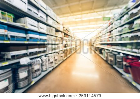 Blurred selection of bedding, sheet sets, comforters on shelves display in store  stock photo