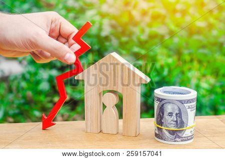a decline in property prices. population decline. falling interest on the mortgage. reduction in demand for the purchase of housing. low prices for public utilities. arrow down. real estate stock photo