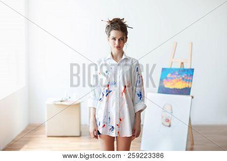 Beautiful woman artist standing in her art studio. Beauty concept stock photo
