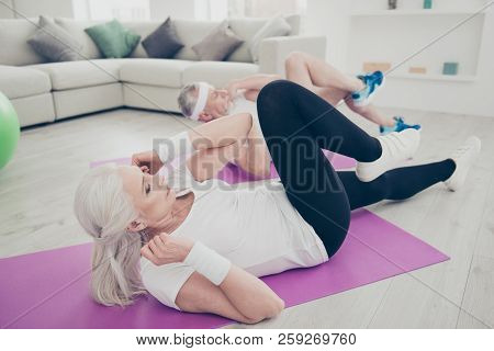 Profile Side View Of Two Adorable Healthy Nice Stylish Sportive Old People Doing Physical Exercise,