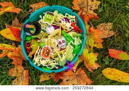 Halloween teal basket with party favors for kids with food allergy. trick-or-treating. Teal pumpkin. the concept of health for children in the Halloween season stock photo