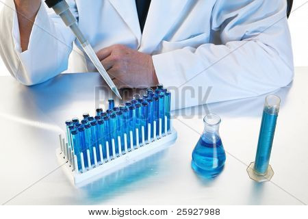 forensic analysis, science, medical, chemistry - a chemist works in his laboratory with various chemicals to document various reactions and interactions. Isolated on white with room for your text. stock photo