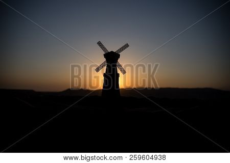 Traditional, Dutch windmill at a hill during a summer sunset. Decoration. Selective focus stock photo