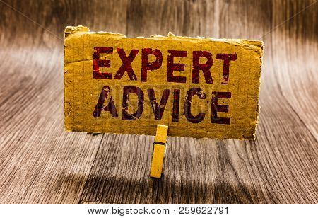 Conceptual hand writing showing Expert Advice. Business photo text Sage Good Word Professional opinion Extensive skill Ace Paper notes reminders question mark asking important answer. stock photo