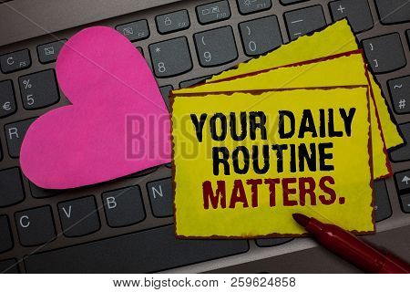 Writing note showing Your Daily Routine Matters. Business photo showcasing Have good habits to live a healthy life Red bordered yellow written paper pinch with love on computer keybaord. stock photo