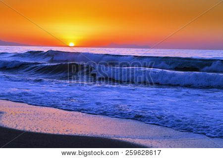 Beautiful sunset in the western part of the island of Crete, near the town of Rethymnon. Seascape. Sunset over the sea. stock photo