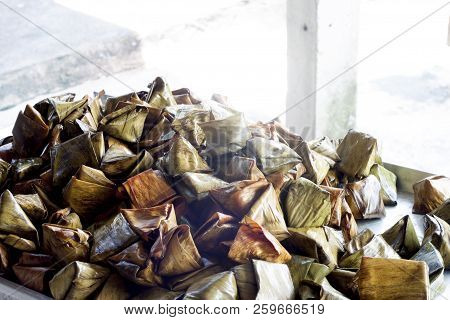 Stuffed Dough Pyramid Wrapped with banana leaves for Chinese New Year or Thai religious holidays. stock photo