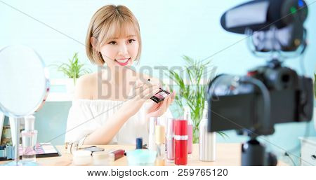 woman show makeup palette in live at home stock photo
