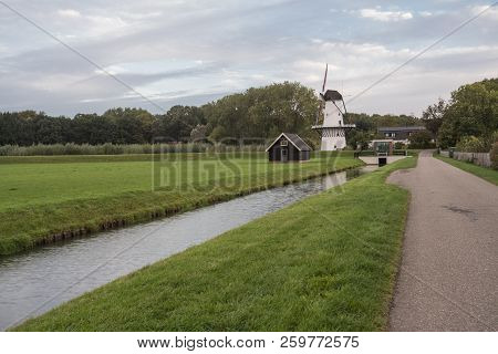 on the water there is an windmills in Deil in Holland stock photo