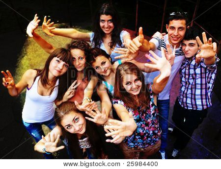 A group of young people dancing at a disco. stock photo