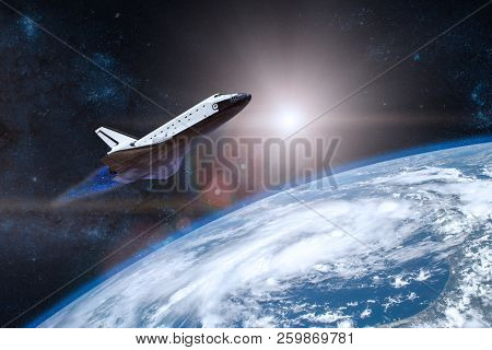 Blue planet Earth. Space shuttle taking off on a mission. Elemen stock photo