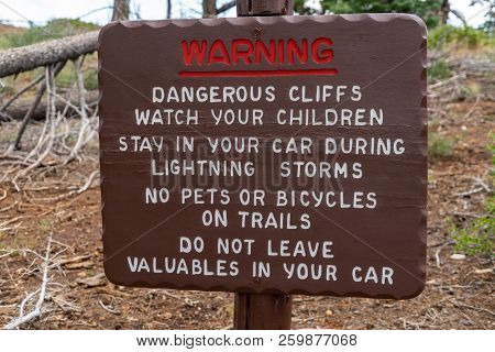 Warning sign posted at Bryce Canyon National Park informs tourists of dangerous conditions on the trails stock photo