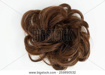 Messy bun on white background. Women's hairstyle and hairdo stock photo
