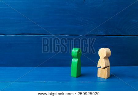 A wooden figure of a man with a crack. Threat of life. Injury and death. Never give up. Motivation. The concept of psychological stress and pressure.Could not stand our nerves and our health. stock photo