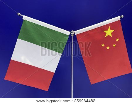 Italian and Chinese flags with a blue background. Concepts: China International Import Expo (CIIE), trade, fair, relationship, economic, forum stock photo