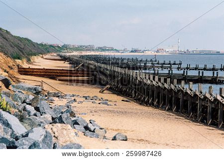 Sea defences between Gorleston and Hopton on the coast of Norfolk, England, with Gorleston beach and town in the distance stock photo