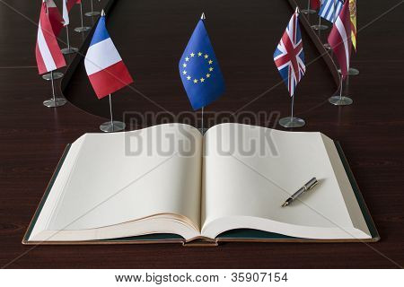 Open spread book with clear pages, fountain pen, EU (European Union) and optional EU nations flags stock photo
