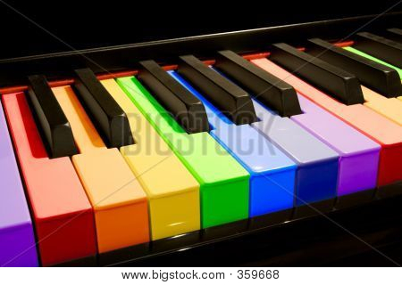 color isolated piano keys in the colors of the rainbow stock photo