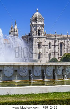 Jeronimos monastery seen from the Imperio garden in Lisbon, Portugal. Classified as UNESCO World Heritage as a masterpiece of the Manueline art. stock photo