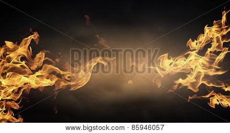 Conceptual picture of blazing flame on dull foundation