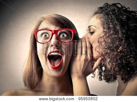 Girls whispering secrets stock photo