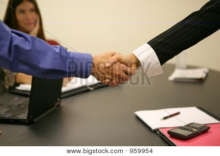a man shaking a woman's hand in the office stock photo