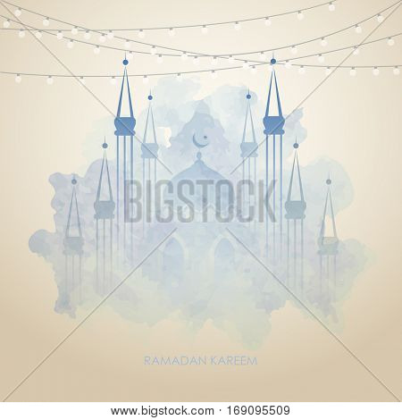 Beautiful mosque, made by colors splash for Islamic holy month of prayers, Ramadan Kareem celebrations. Ramadan greetings background. View of mosque in blue grunge night background with shiny lights. stock photo