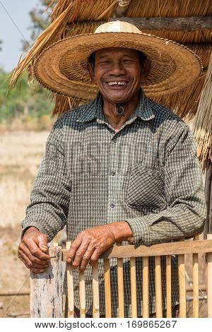 70-79 Years Portrait of friendly senior asian adult man with straw hat stock photo
