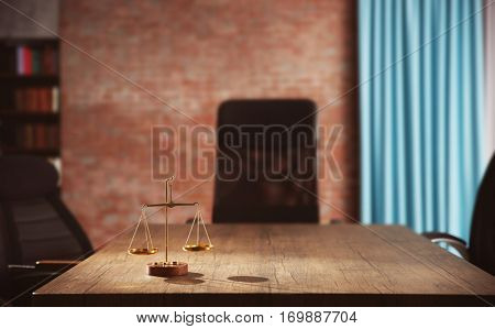 Symbol of law and justice on wooden table in lawyer office stock photo
