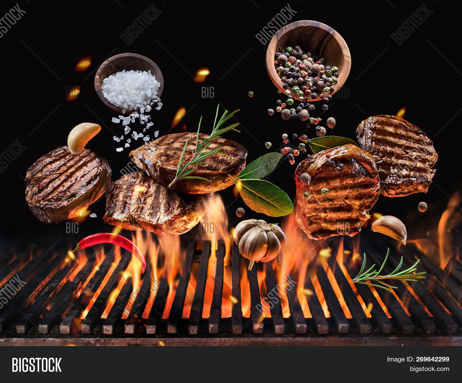 bar,barbecue,barbeque,bay leaf,bbq,beef,beefsteak,black background,blazing,cook,cooking,dark,dinner,fall,fire,fly,food,fork,garlic,glowing,grill,grille,grilled,grilled steaks,grilling,hamburger,isolated,levitation,meal,meat,move,open fire,outdoor,pepper,ribeye,roast,rosemary,salt,slice,steak,steak grill,vegetables