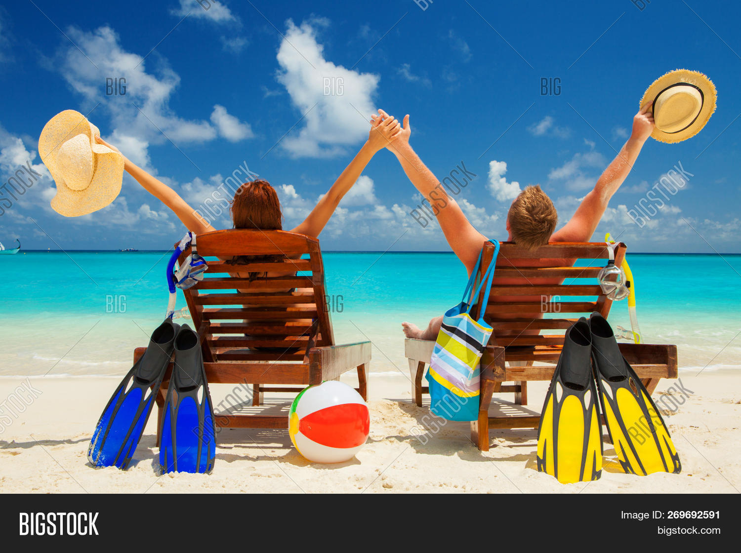 Happy family vacation at Paradise. Couple relax on the white sand of beach. Happy sea lifestyle. You