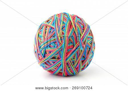 Colorful cotton big thread ball from four color thread isolated on white background. Different color pink, green, grey, blue thread mix. stock photo
